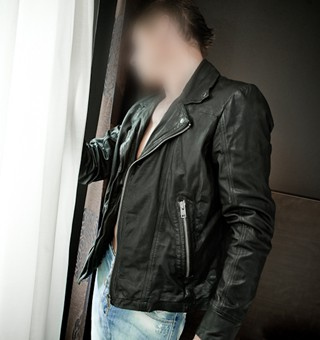 Gigolo David in leather jacket and torn jeans