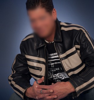 Gigolo David jeans and leather jacket squatted